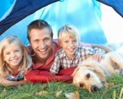young-family-camping-with-dog
